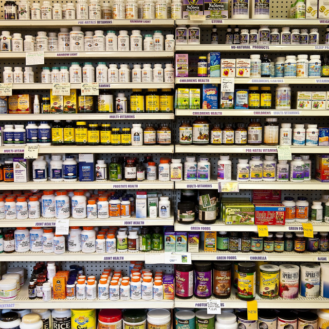"""Vitamin shelf of a health food store."" stock image"