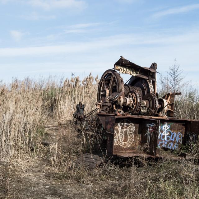 """Abandoned piece of machinery with graffiti sprayed onto it"" stock image"
