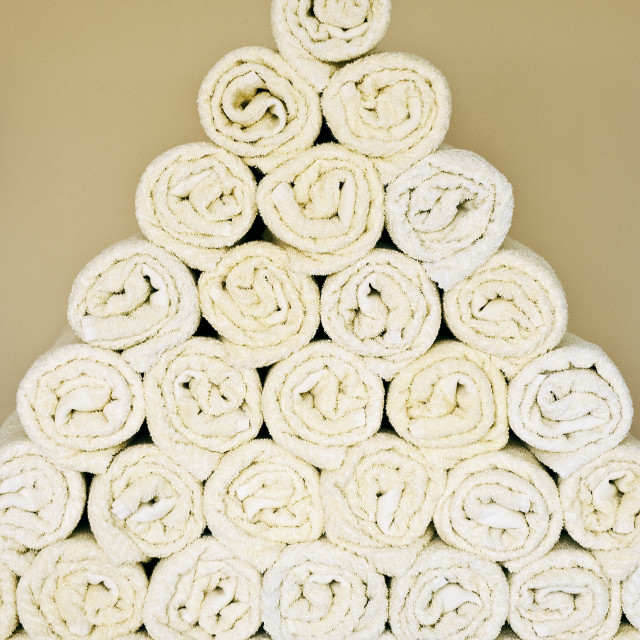 """""""Neatly stacked towels at a health spa."""" stock image"""