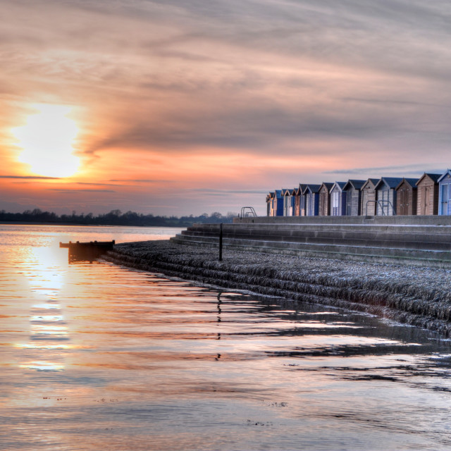 """Beach huts in the evening light"" stock image"