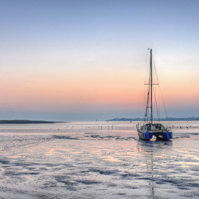"""Low tide at the sailing club"" stock image"