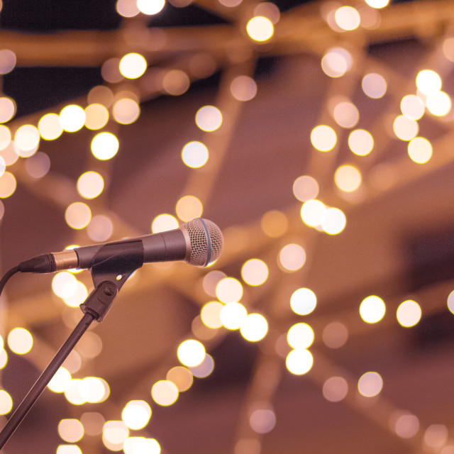 """""""Microphone on stand with nice soft blurred lights background."""" stock image"""