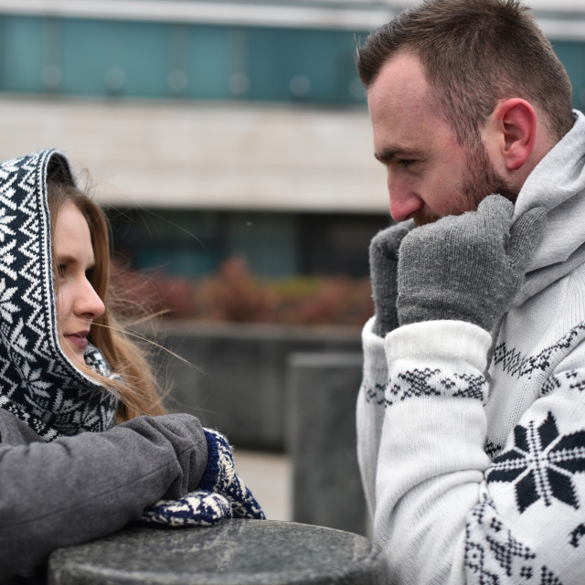 """couple outdoor looking at each other"" stock image"