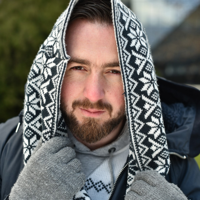 """young man with woolen hoodie over his head"" stock image"