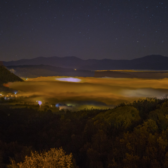 """Fucino valley under a cloudy fog"" stock image"