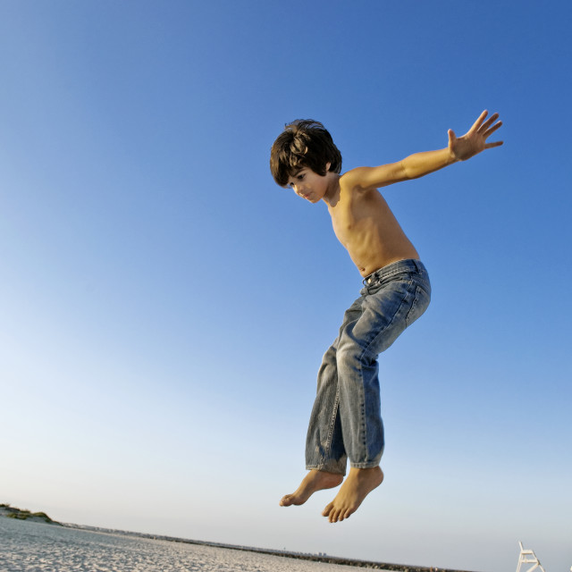 """""""Boy jumping from a lifeguard stand."""" stock image"""