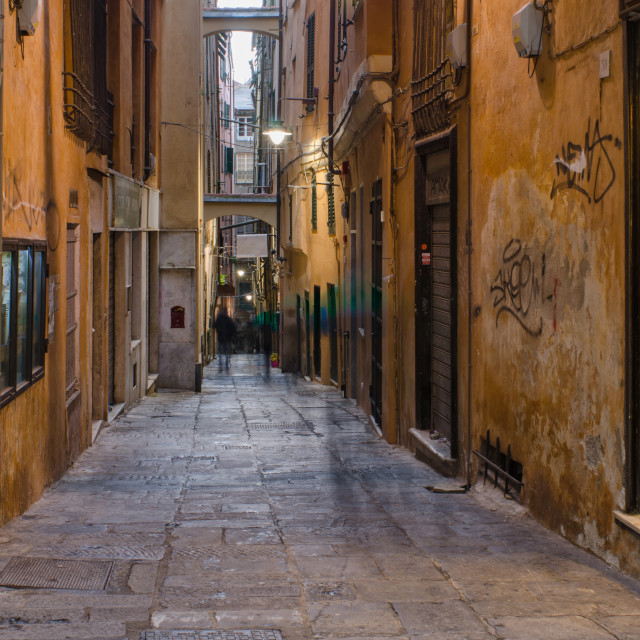 """""""Shadows On The Street In Genoa"""" stock image"""