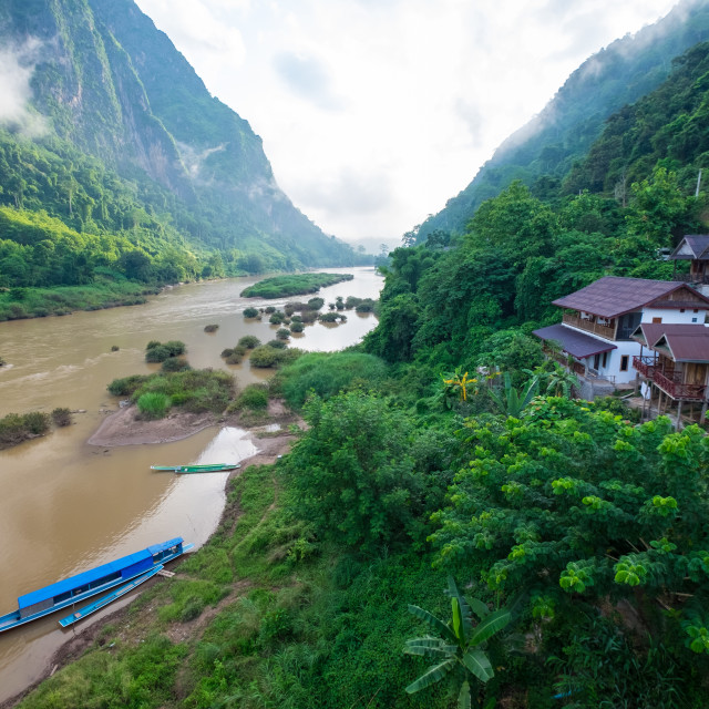"""""""Bamboo boat on river in early mornng"""" stock image"""
