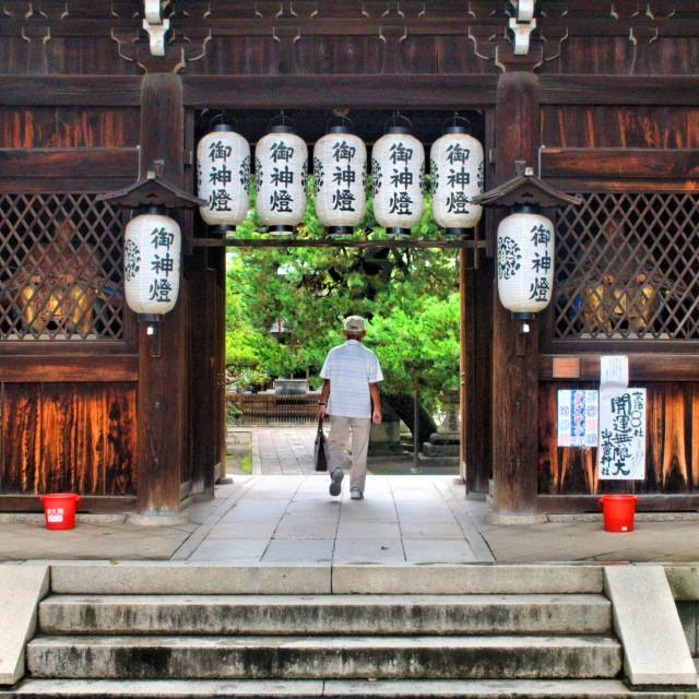 """Man walking into a shrine"" stock image"