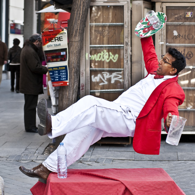 """Waiter falling street performer, Madrid, Spain"" stock image"