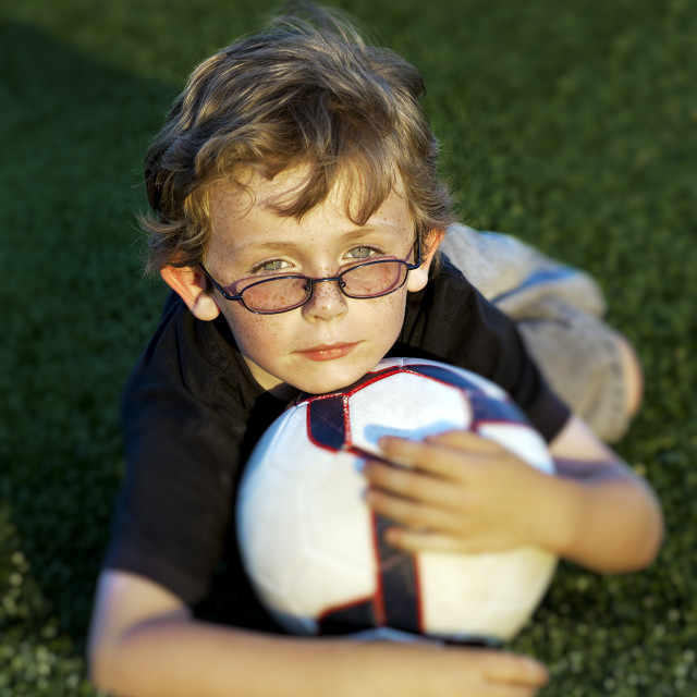 """""""Portrait of boy with soccer ball."""" stock image"""