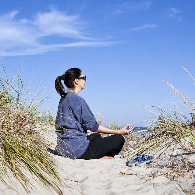 """""""Woman practicing yoga at the beach, Cape Cod."""" stock image"""