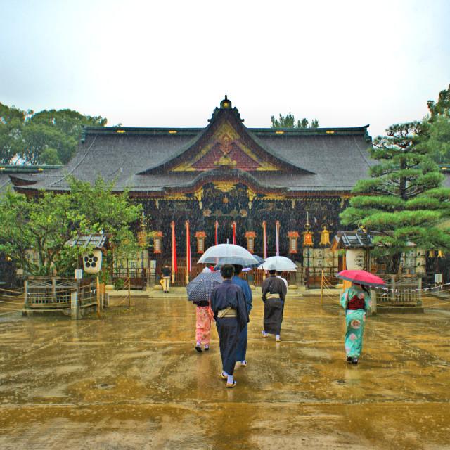 """Walking in Kimono in the rain"" stock image"