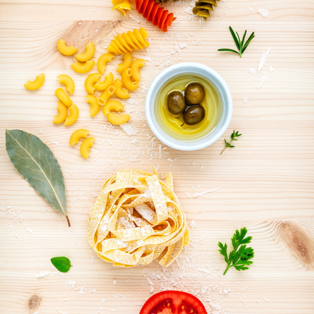 """""""Italian food concept various kind of pasta with olive oil flavored and spices..."""" stock image"""