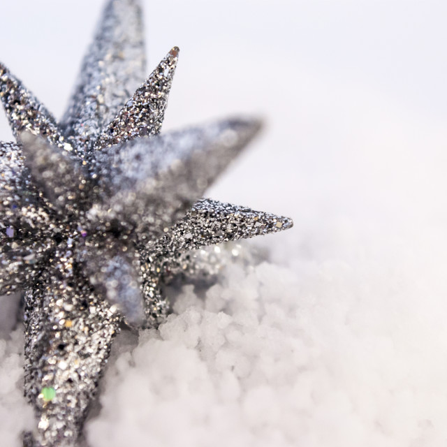 """Christmas Glitter Star Decoration in White Snow"" stock image"