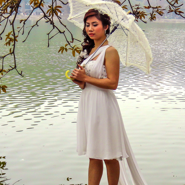 """Bride at a lake in Hanoi"" stock image"