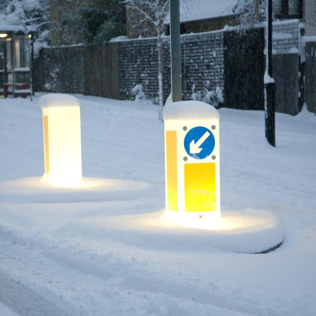"""Bollards in snow"" stock image"