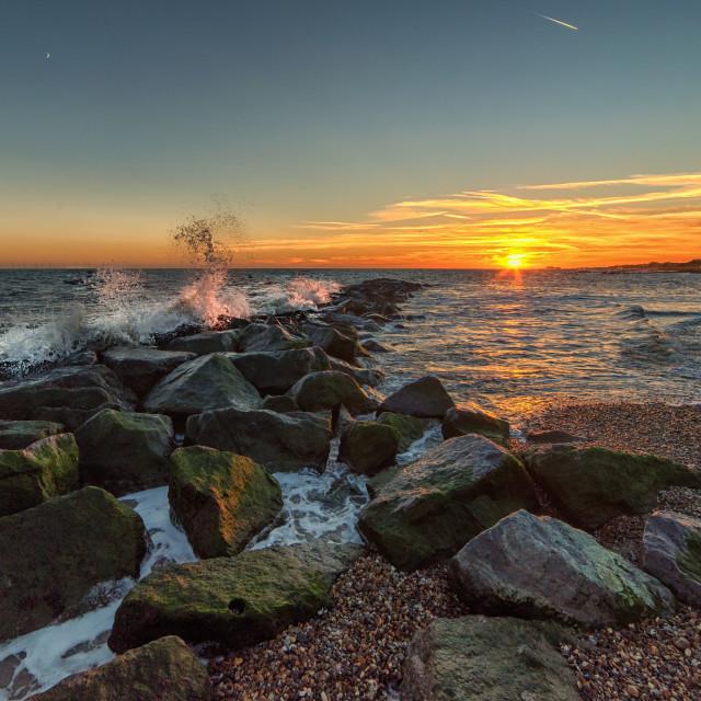 """Rough December Sunset on Clacton Beach"" stock image"