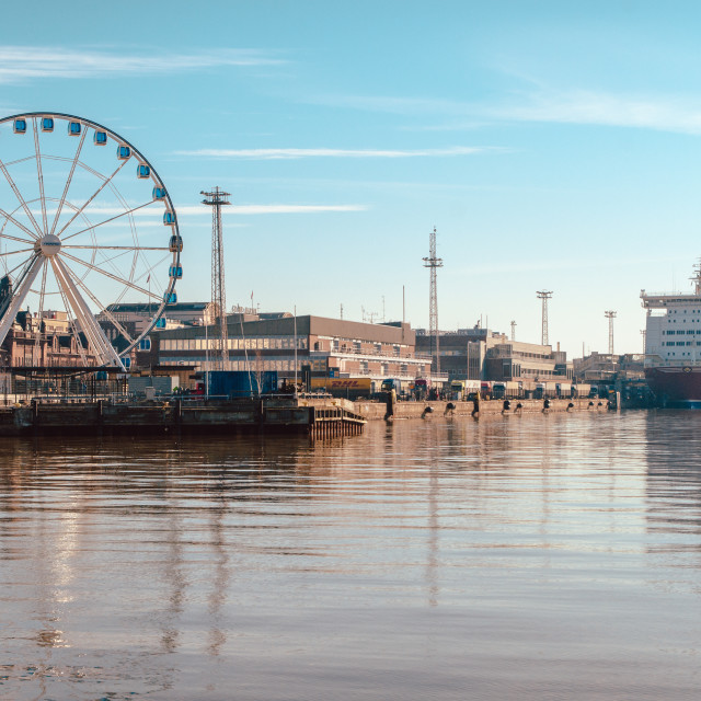 """""""View of the Ferris wheel, the port and Viking ferry with beautiful reflection on the sea in Helsinki Finland"""" stock image"""