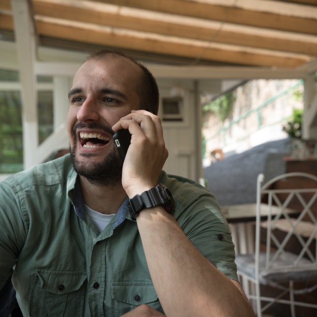 """young man talking on cellphone"" stock image"