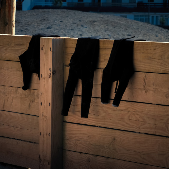 """""""Wetsuits drying"""" stock image"""