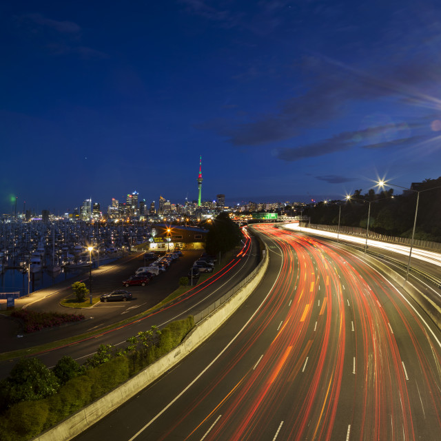 """Busy Traffic Auckland with the Skytower lit in Christmas"" stock image"