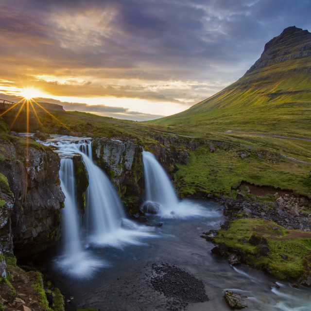 """Iceland waterfall and mountain scene"" stock image"