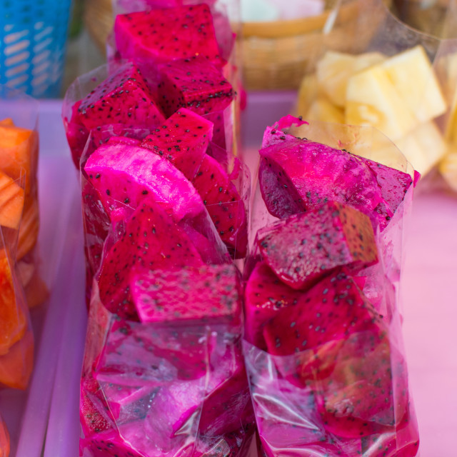 """Cut dragon fruit on the fruit market"" stock image"