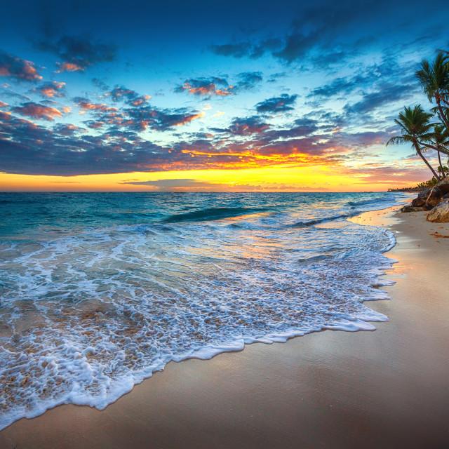 """Sunrise over the beach"" stock image"