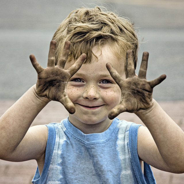 """Boy with dirty hands."" stock image"