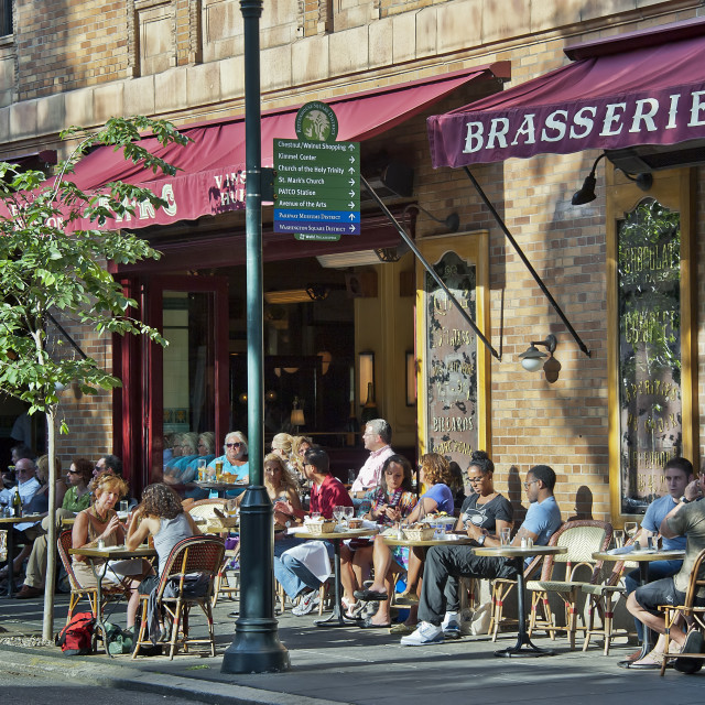 """Diners enjoy sidewalk seating at a Philadelphia restaurant, Pennsylvania"" stock image"