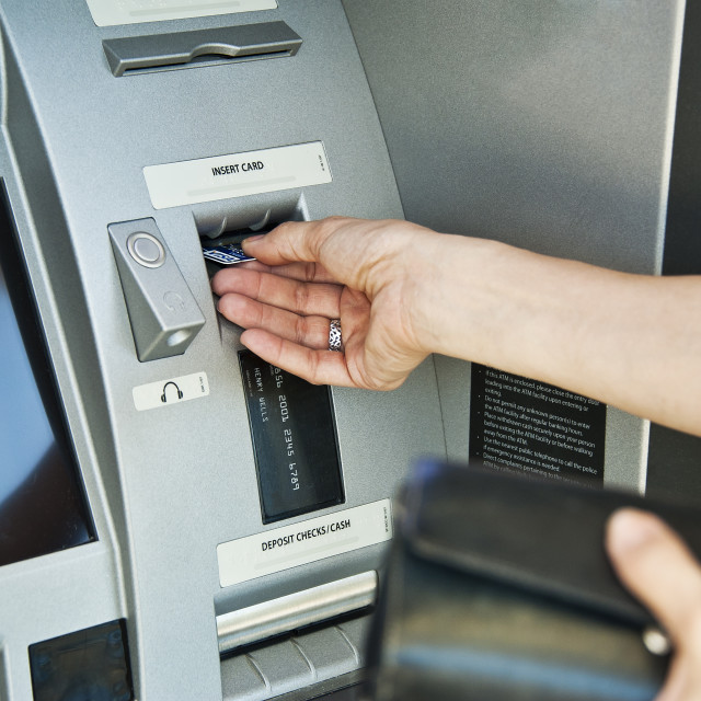 """ATM transaction."" stock image"