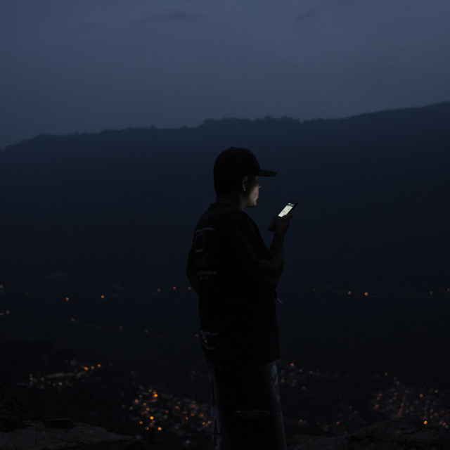 """""""On top of the world, looking for mobile phone signal"""" stock image"""