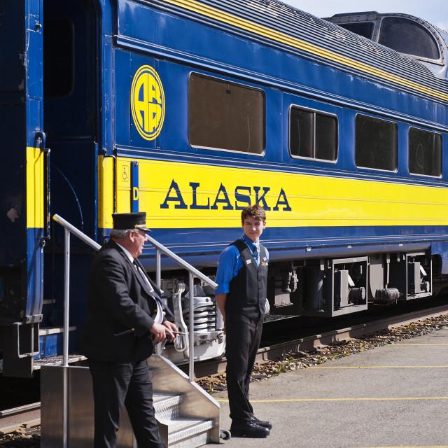 """Conductor and clerk await passengers aboard an Alaska Railroad train, USA"" stock image"