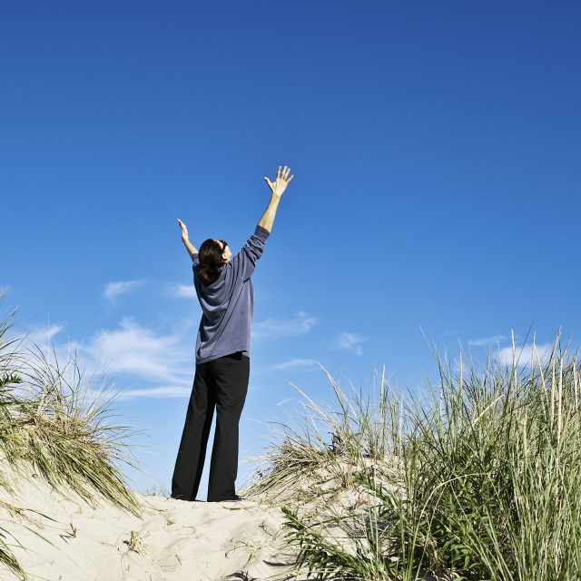 """""""Woman opens her arms in thankful gratitude."""" stock image"""
