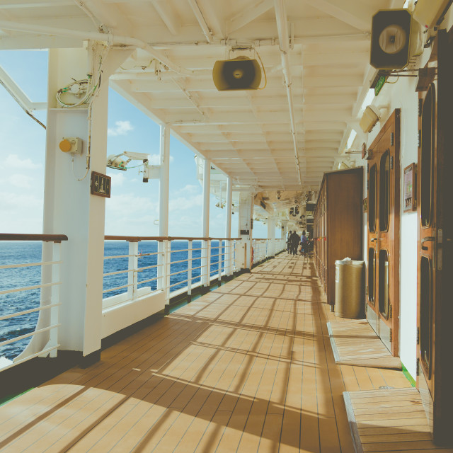 """Cruise wooden deck with metal barrier in sunset rays light at At"" stock image"