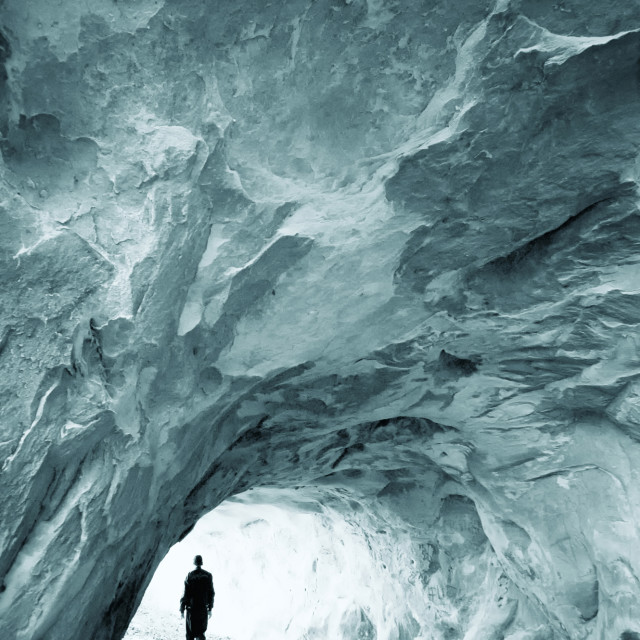 """Man in ice cave"" stock image"