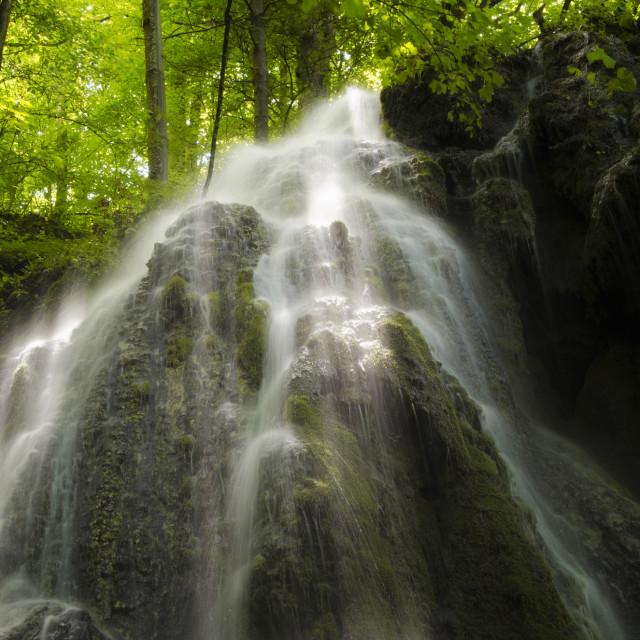 """Waterfall on cliffs on mountain rver"" stock image"