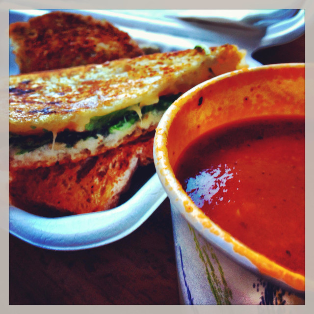 """Lunch of a grilled cheese sandwich and a cup of tomato soup."" stock image"