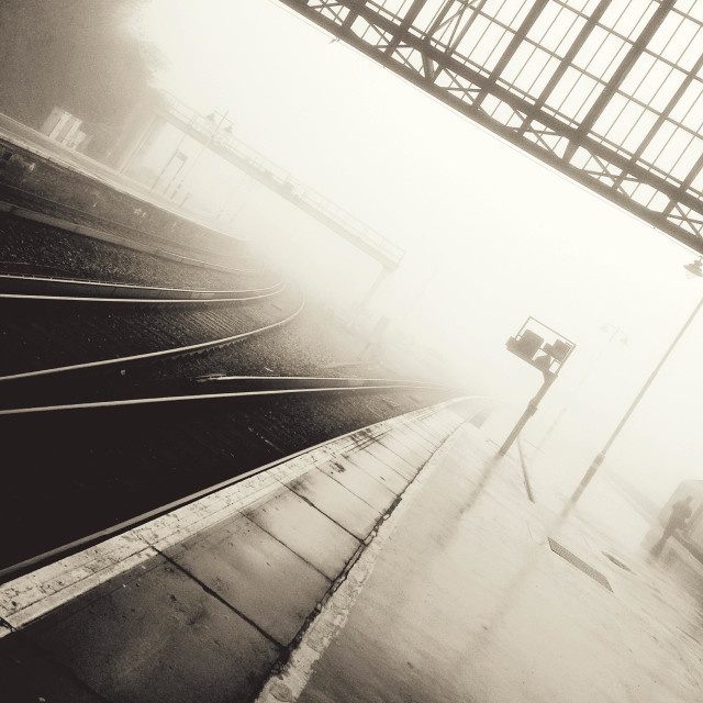 """Train station in fog"" stock image"