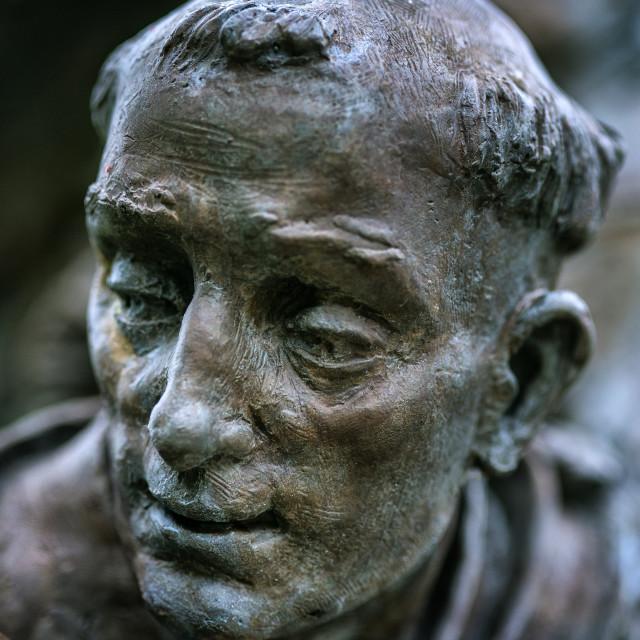 """Sculpture detail of Christian Saint."" stock image"