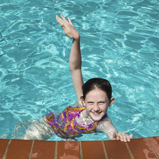 """""""Delighted girl in a swimming pool."""" stock image"""