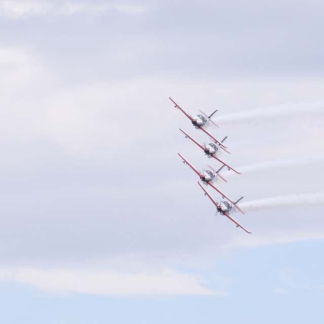 """""""Collaboration of four planes flying in blue sky"""" stock image"""
