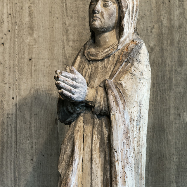 """Ancient christian religious sculpture of a prayerful believer."" stock image"