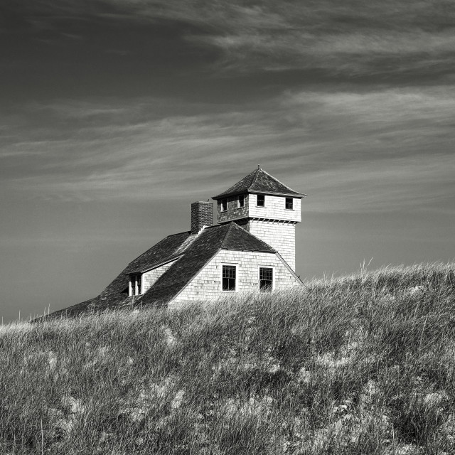 """""""Secluded beach house nestled in the dunes."""" stock image"""
