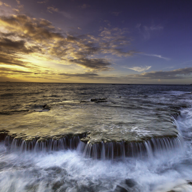 """Waterfalls on the ocean"" stock image"