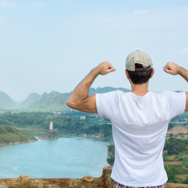 """""""Powerful hiker enjoying at the viewpoint"""" stock image"""
