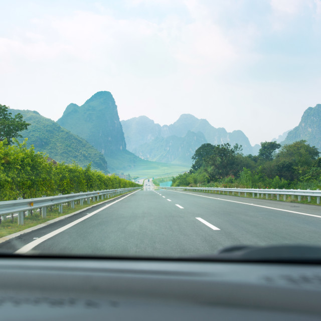 """""""Driving through karst scenery in Guangxi province, China"""" stock image"""