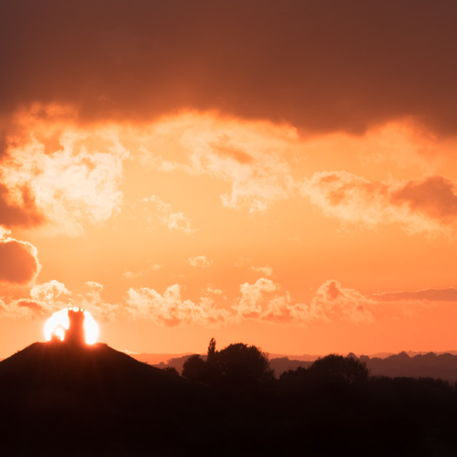 """Sunset behind Burrow Mump"" stock image"
