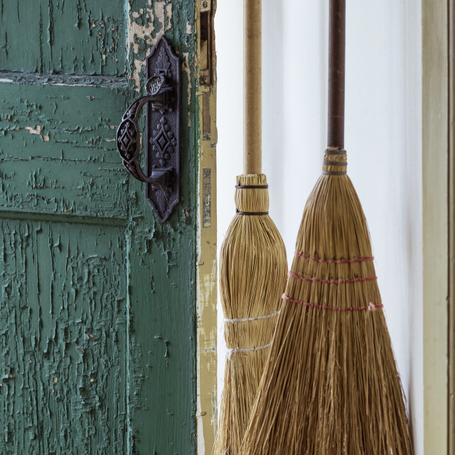 """""""Broom and old door in traditional Shaker house."""" stock image"""